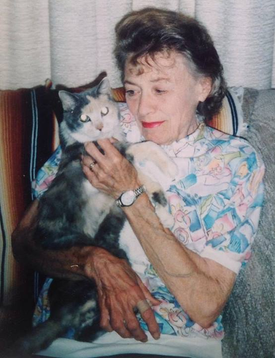 Marie Nedland and cat at Monroe Manor